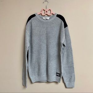 H&M gray ribbed sweater with black patches
